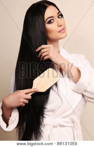 Beautiful Sensual Woman Combing Her Luxurious Healthy Hair