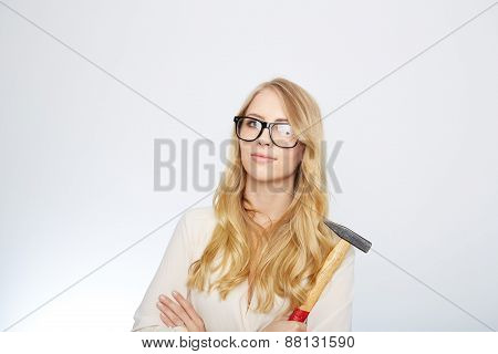 girl with a hammer and nerd glasses. isolated on white