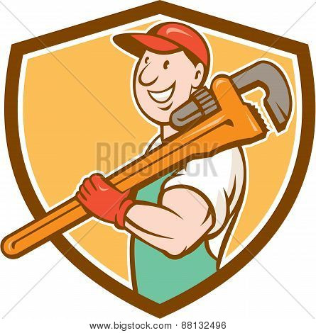 Plumber Smiling Holding Monkey Wrench Crest