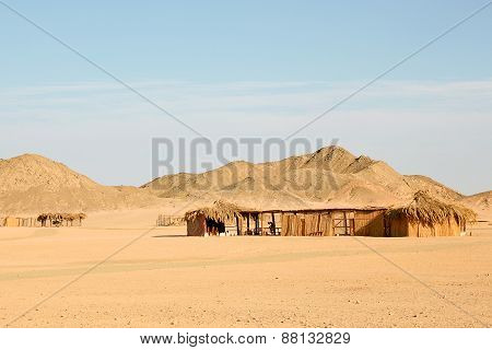 Traditional Rural African Reed And Thatch Hut.