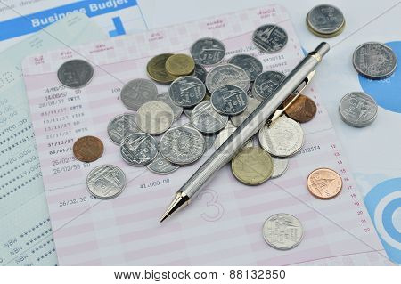 Pen And Coin On Saving Book