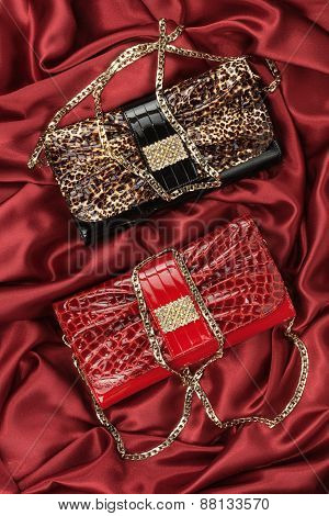 Red And Leopard Bag  Lying On Red  Fabric