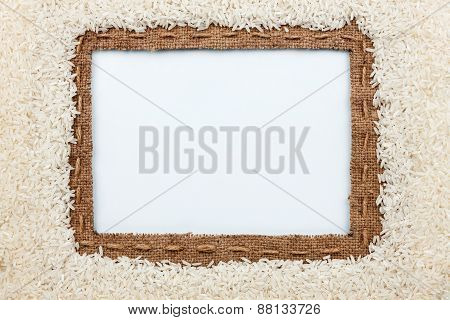 Frame Made Of Burlap With The Line And  Rice  Grain  Lies On White Background