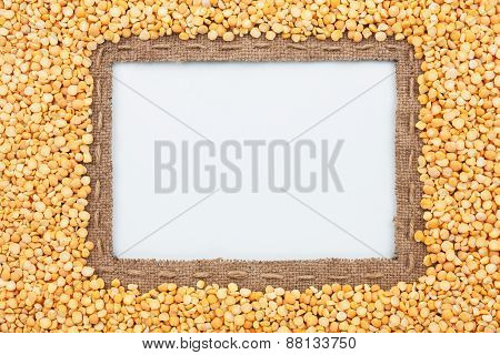Frame Made Of Burlap With The Line And  Grain Pea  Lies On White Background