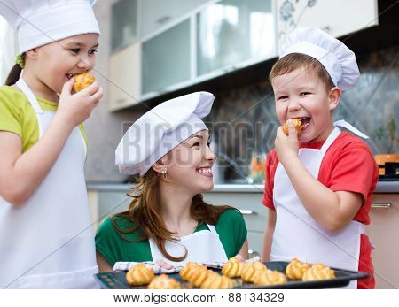 Mother With Children Making Bread