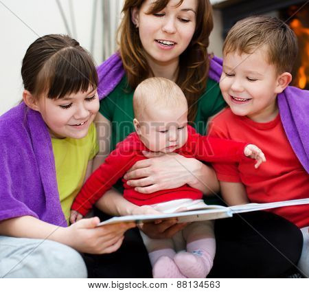 Mother Is Reading Book With Children