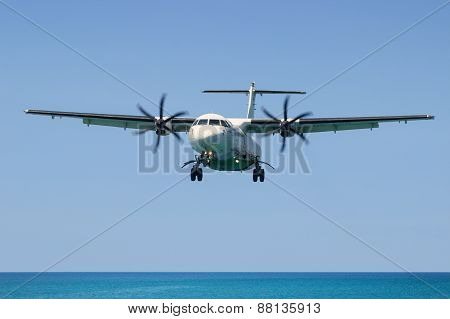 Turboprop Aircraft Atr 72, Landing In Phuket International Airport In Thailand