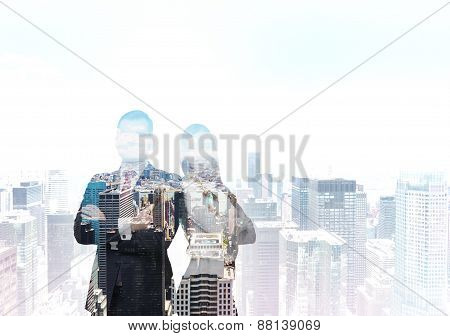 The Silhouette Of The Couple Of Professionals Over The New York City. A Concept Of International Con