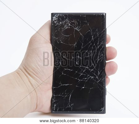 Hand Holding A Mobile With Broken Screen
