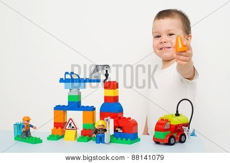 child playing in the constructor