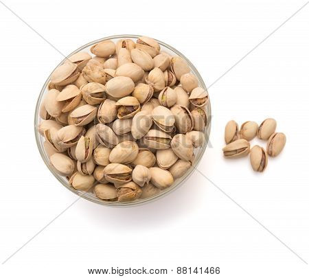 Pistachio Nuts In A Glass Bowl On White With Clipping Path, Top View