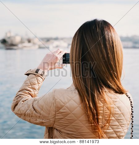 Fashion  Woman Taking Photo With Cellphone