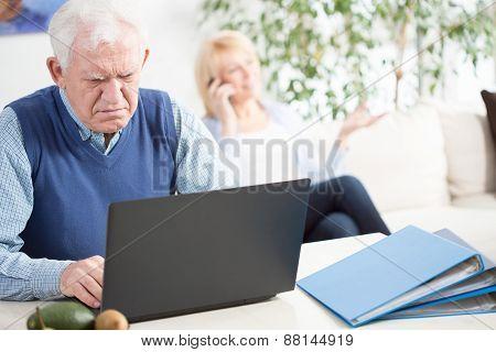 Worried Elder Man Working