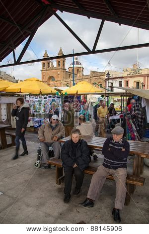 MARSAXLOKK, MALTA - JANUARY 11, 2015: People at Marsaxlokk market, one of the city's main features especially on sunday.