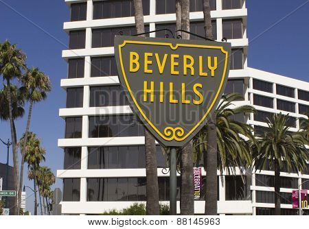 Beverly Hills Sign With A Modern Building