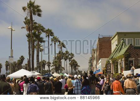 Crowd Of People Walking Along Venice Beach