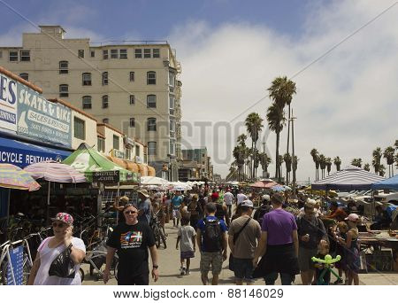 Crowd Of People Walking On The Main Promenade Along Venice Beach