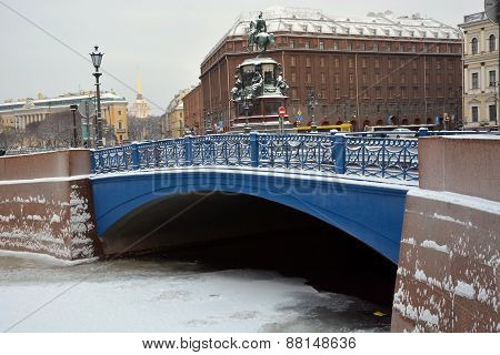 Famous Blue Bridge In Saint-petersburg And St. Isaac Square