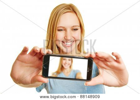 Blonde young woman taking a selfie with her smartphone