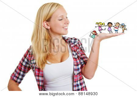 Young woman with illustrated cartoon children on her hand