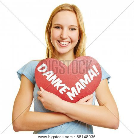 Happy girl holding a red heart with German text