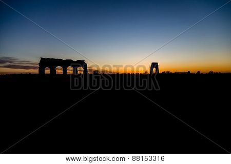 Sunset With Silhouette Of The Park Of Acquedotti In Rome