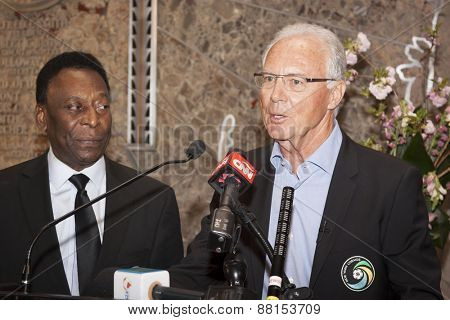 NEW YORK - APRIL 17, 2015: Soccer legends Franz Beckenbauer and Pele at the ceremony to light the Empire State Building Cosmos Green to launch and celebrate the start of the teams 2015 spring season.