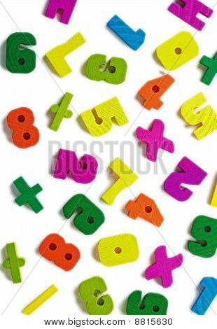 Wooden Figures Scattered On White Background