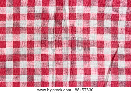 Red linen picnic tablecloth background.