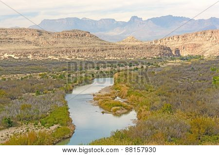 Meandering River Through A Desert Canyon