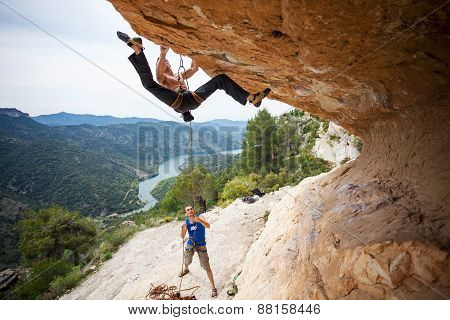 Man starting to climb challenging route