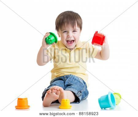kid playing with color toys