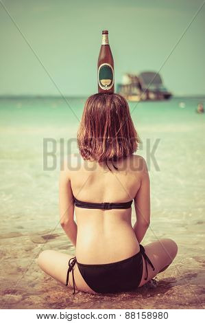 Sexy Asian Thai Girl Is Sitting In The Salt Water On The Seashore With Bottle On Her Head In Vintage