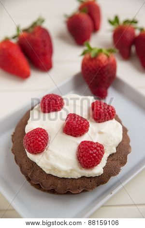 Small Chocolate Cake with clotted cream and raspberries
