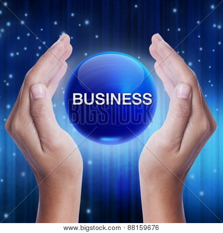 Hand showing blue crystal ball with business word