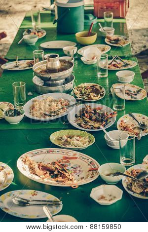 Remaining Plates Leftover On The Table With Remaining Thai Food In Vintage Color