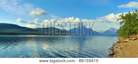 Mountains And Reflection Of Clouds In Mcdonald Lake In Glacier National Park