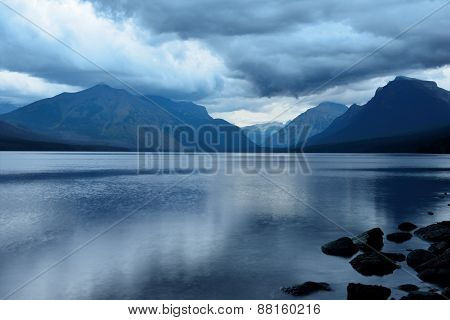 Storm In The Mountains At Mcdonald Lake In Glacier National Park After Sunset