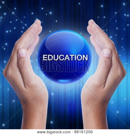 Hand showing blue crystal ball with education word.