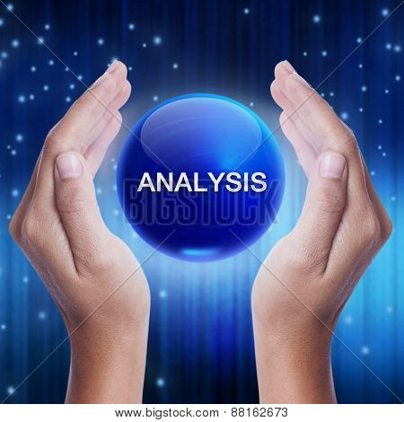 Hand showing blue crystal ball with analysis word.