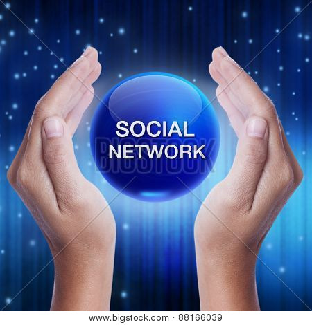 Hand showing blue crystal ball with social network word.