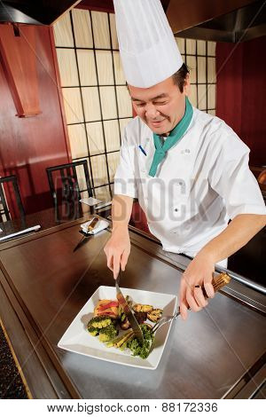 Cook serves dish to a client