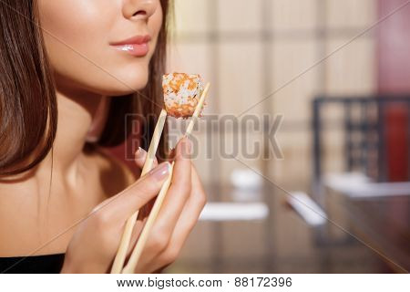 Woman eats a roll