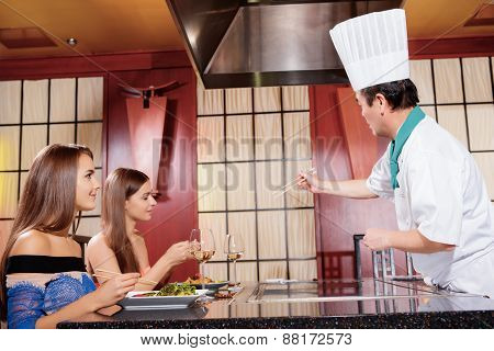 Female clients in Japanese restaurant
