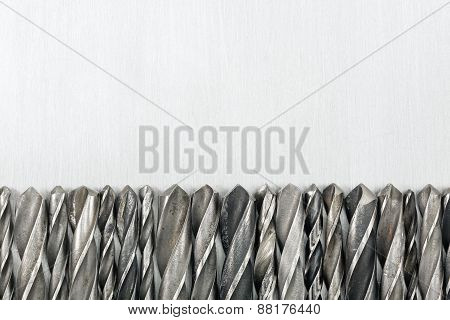 Drill Bits On Metal Background