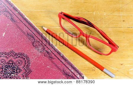 Book, Pen And Pair Of Red Glasses