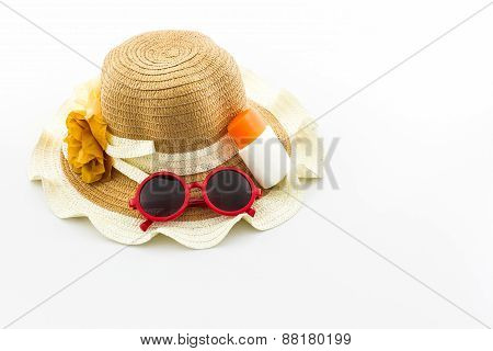Woven Hat With Body Lotion And Red Sunglasses.
