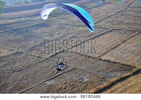 Udonthani, Thailand -february 15 2015: An Unidentified Dudek Paramotor. Photo In Red Lotus Sea Udont