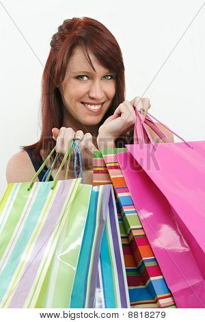 Redhead Holding Shopping Bags