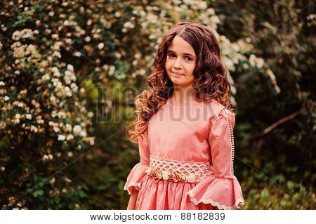 summer portrait of happy child girl in pink fairytale princess dress